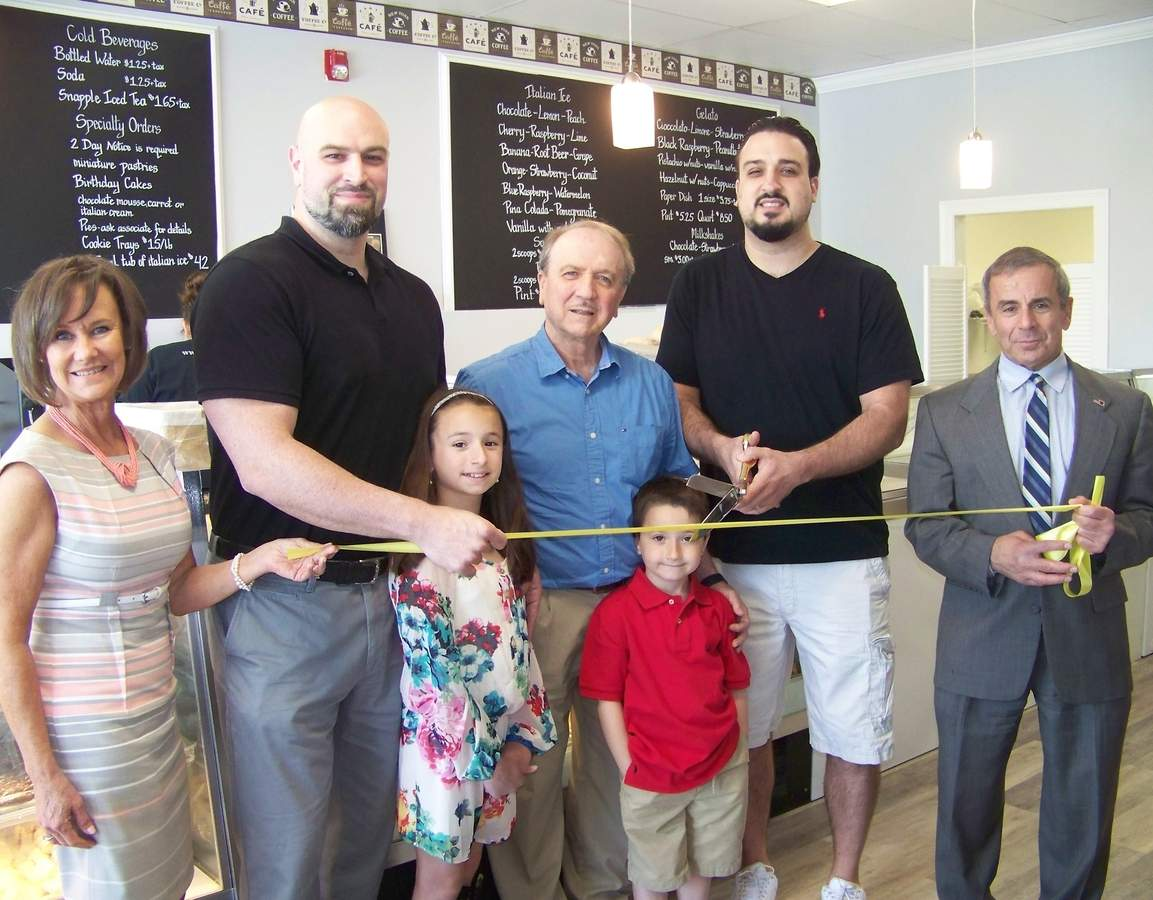 Picture from left to right are Quinnipiac Chamber Executive Director Dee Prior Nesti, Libby's co-owner Sal D'Angelo, his father Antonio D'Angelo, co-owner Mark D'Angelo, First Selectman Mike Freda, and Sal D'Angelo's children.   Photo courtesy of the Quinnipiac Chamber of Commerce