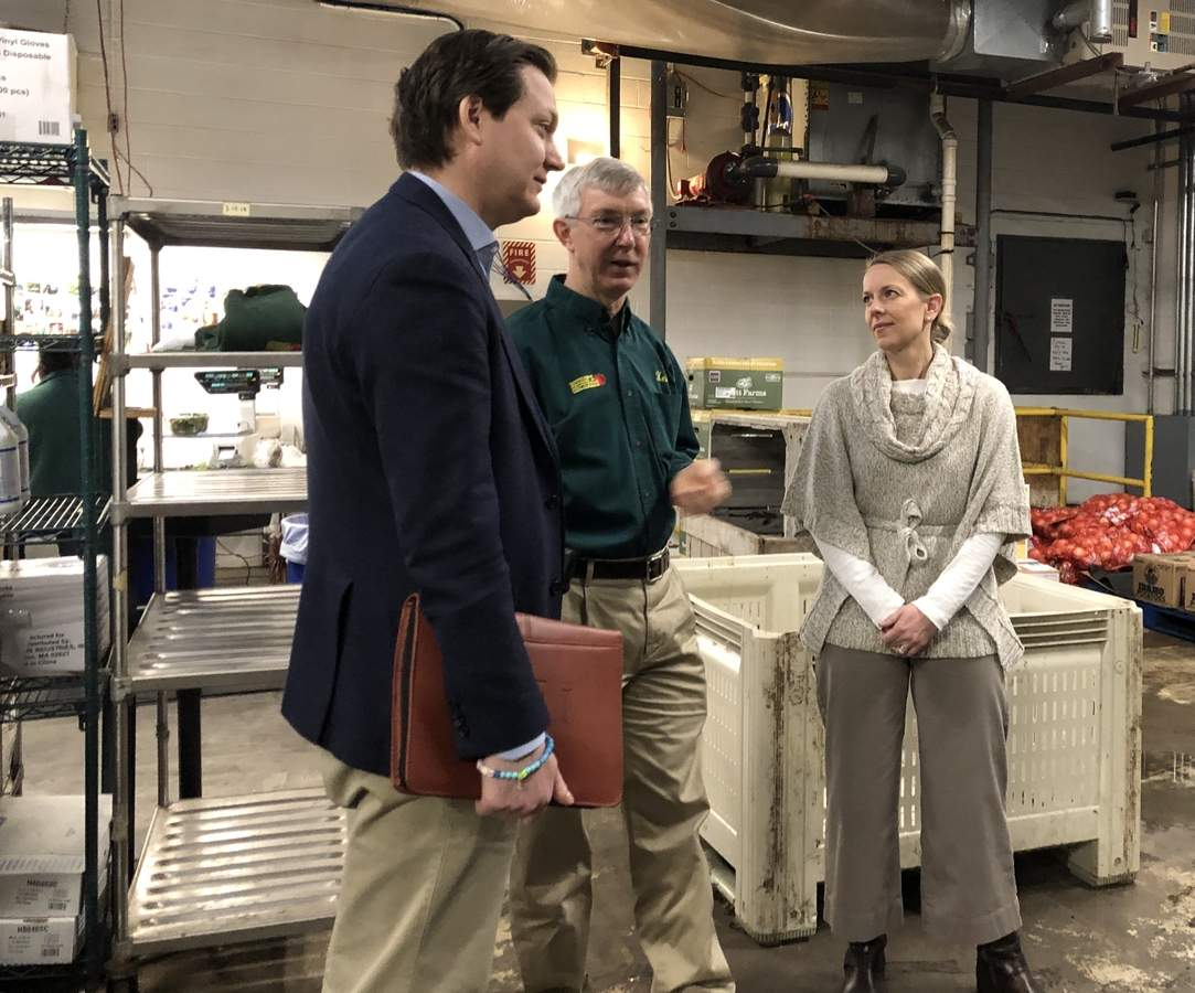 From left, Connecticut Farm Bureau Executive Director Bryan Hurlburt, Bishop's Orchard Farm Market & Winery Co-CEO and Winemaker Keith Bishop, and State Senator Christine Cohen (D-12) tour Bishop's Farm Market & Winery and discuss pending legislation concerning cider sale laws. Photo by Zoe Roos/The Courier