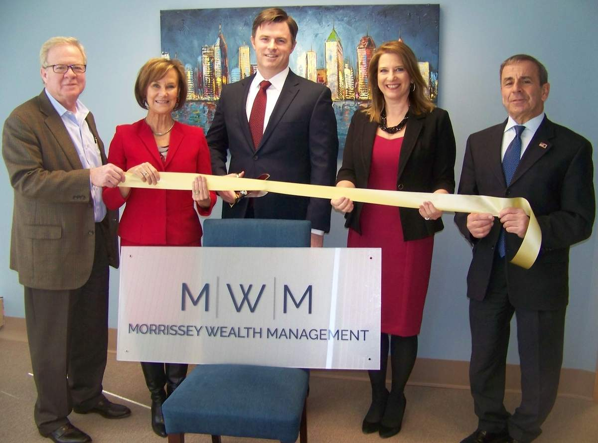 From left, Quinnipiac Chamber of Commerce Board Chair Tom Curtin of Ulbrich Stainless Steels, Quinnipiac Chamber of Commerce Executive Director Dee Prior-Nesti, Morrissey Wealth Management financial advisor and owner Ryan Morrissey, financial advisor Cheryl Thomas, and First Selectman Mike Freda cut the ribbon at Morrissey Wealth Management. Photo courtesy of Maribel Carrion