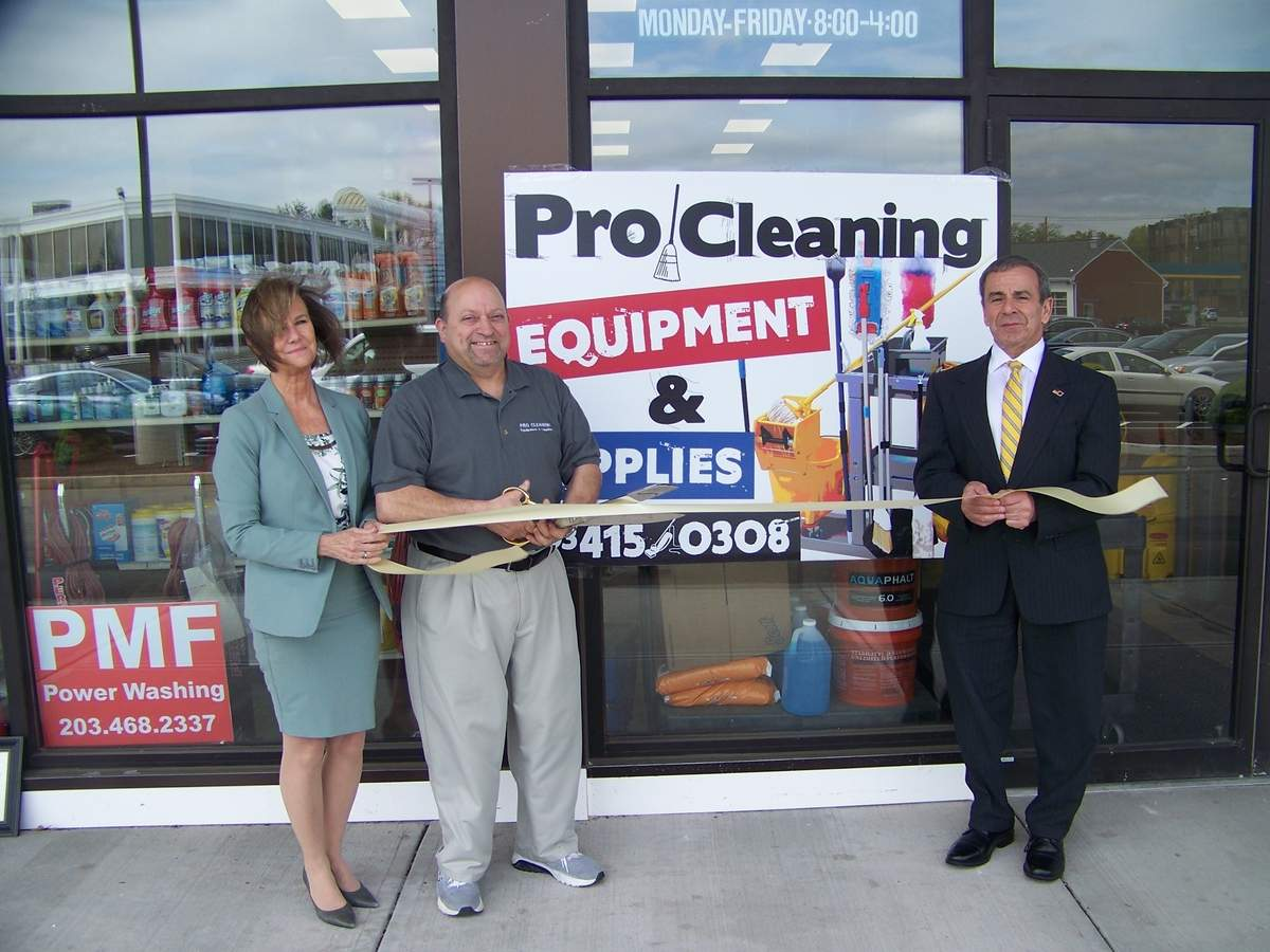 From left, Quinnipiac Chamber of Commerce Executive Director Dee Prior-Nesti, Pro Cleaning Equipment & Supplies owner Bob Fournier, and First Selectman Mike Freda cut the ribbon on May 7. Photo courtesy of Dee Prior-Nesti