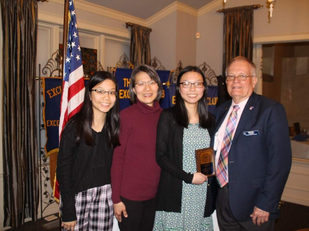 The Exchange Club of Madison June 2019 Youth of the Month Claire Chang (second from right, accompanied by her sister Aimee Chang and mother Anna Chang) accepts a $300 award and a commemorative plaque from Exchange Club of Madison Youth of the Month and Year Program Chair David Bell. Photo courtesy of Ashton Edwards