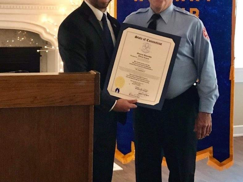 State Representative Joseph Zullo (R-99) presents a Connecticut state legislative official citation to East Haven Firefighter Ronald Rascati, who is the longest-serving firefighter in the department with more than 38 years. Photo courtesy of Frank Gentilesco, Jr.