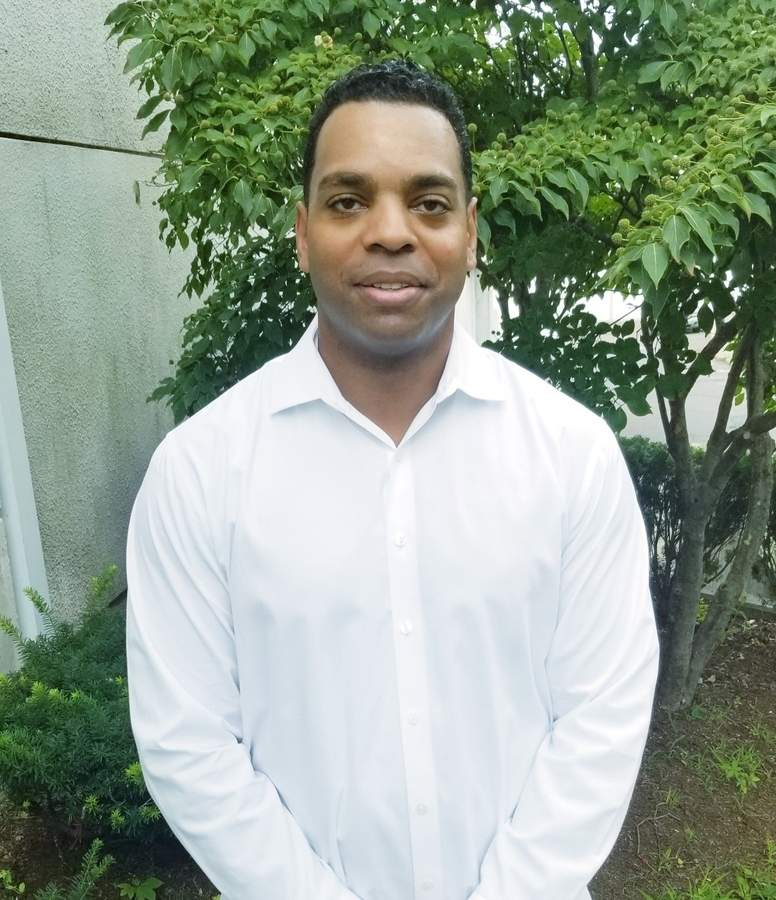 Rashaad Roach, a 2001 East Haven High School graduate, will be inducted into the East Haven Alumni Association Hall of Fame for his contributions to Yellowjackets' football, basketball, and track programs. Rashaad has worked in the Branford Police Department since 2007. Photo courtesy of Rashaad Roach