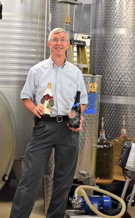 Bishop's Orchards may be best known for apples, but co-CEO Keith Bishop is also winemaker for the company. Now proprietor of Connecticut's only commercial cranberry bog, located in Killingworth, the winery and market can also add home-grown cranberries to its ingredients list. Photo by Maria Caulfield/The Courier
