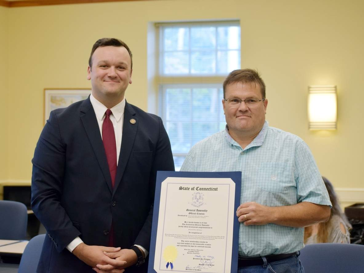State Representative Jesse MacLachlan (R-35) presents 2019 Law Enforcement Officer of the Year Sergeant Bryan Pellegrini (at right) with a legislative citation.   Photo courtesy of Jason A. Pheasant