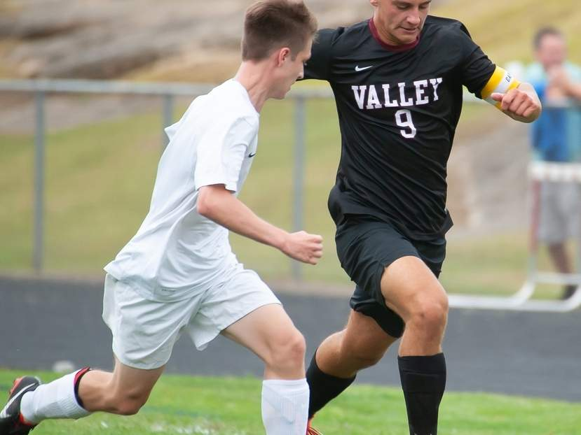 Senior captain Cameron Frazier and the Valley boys' soccer team notched two more victories last week to move to 4-2 on the season. Frazier got an important steal and a key assist in the Warriors' win versus H-K on Sept. 24. File photo by Kelley Fryer/The Courier