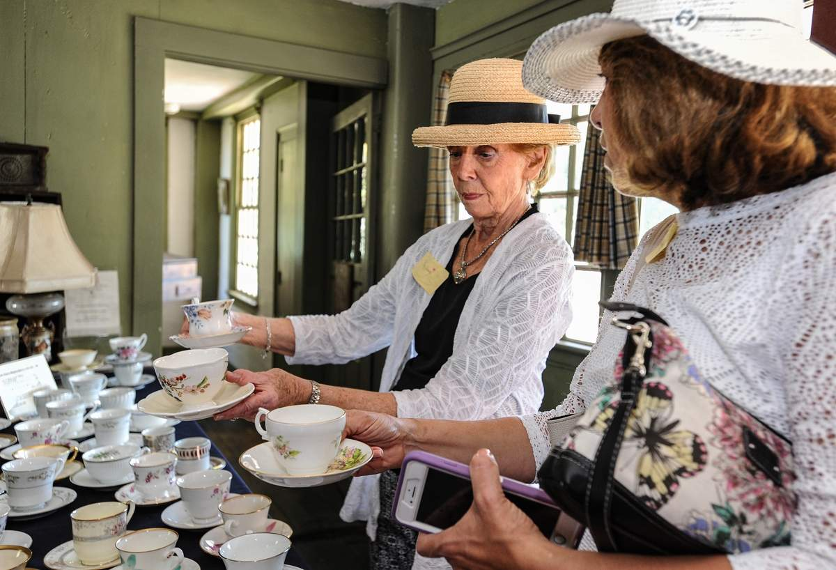 The Adam Stanton House held a Tea Party Fundraiser Sunday September 29th.  The high tea menu included scones, lemon curd, tea sandwiches, desserts, and a variety of tea. Proceeds from the event benefit the Stanton House for its roof repairs  Mary Jane D'Agostino and Dorothy LoMazzo choose their tea cups for the tea.   Photo by Susan Lambert/Harbor News
