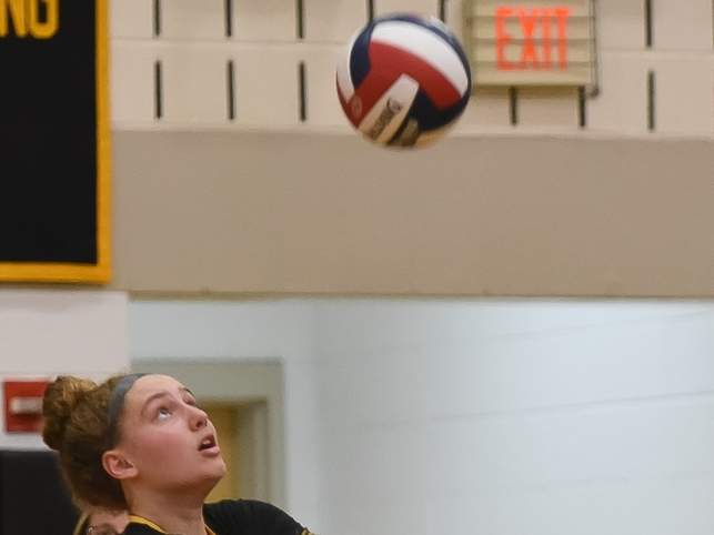 Senior Summer Adams and the Tigers qualified for states by posting a 3-0 sweep against Cross on Oct. 7. Hand went on to beat Lyman Hall and lose to Shelton later in the week. File photo by Kelley Fryer/The Source