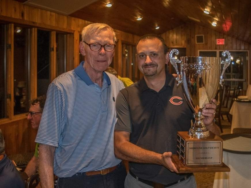 Clinton's Dave Russo defended his crown at the Shoreline Golf Society Founders Cup championship by winning the tournament for the second year in a row. Pictured is tournament director Mike Dore with Russo at the event. Photo courtesy of Mike Dore