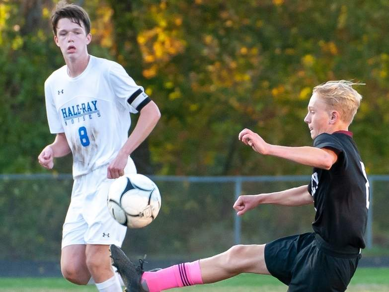 Sophomore Jake Burdick (right) and the Valley Regional boys' soccer team qualified for the Class M State Tournament by earning a tie against Hale-Ray on Oct. 14. Burdick has been an offensive weapon for the Warriors with 12 goals on the season.  Photo by Kelley Fryer/ The Courier