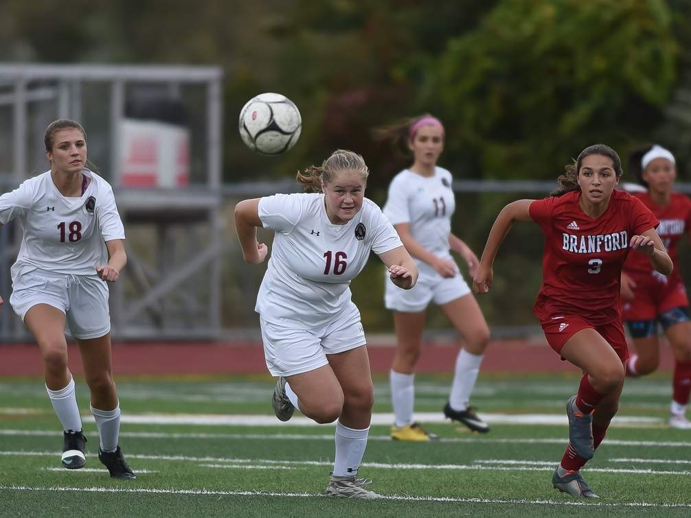 Junior Carly Fresher (No. 16) and the North Haven girls' soccer squad continued making strides by picking up a tie and a win during last week's games. Pictured on the left for the Indians is No. 18, senior Katie Ryan. File photo by Kelley Fryer/The Courier