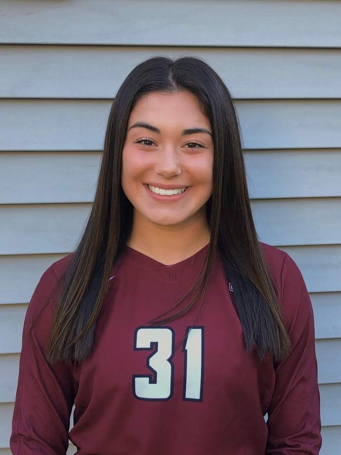 Junior Alex Ferriouolo is settling quite nicely to her role as a defensive specialist while playing the libero position for the North Haven volleyball squad. Photo courtesy of Alex Ferriouolo