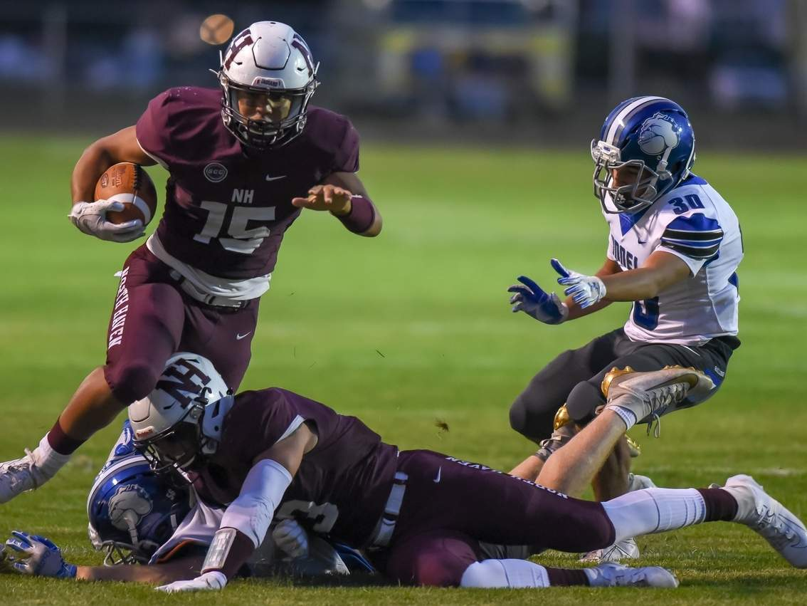 Senior Max Augustine ran for 130 yards and three TDs when the North Haven football team shut out Pomperaug by a 41-0 score in a road game on Oct. 25. Pictured making the pancake block for Augustine is No. 13, senior captain Joe Vitale. File photo by Kelley Fryer/The Courier