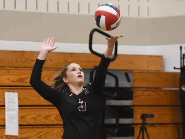 Senior Eryn Sheeley dealt out eight aces to help the Indians lock up a spot in the State Tournament with a 3-0 win over Sheehan on Oct. 22. File photo by Kelley Fryer/The Courier