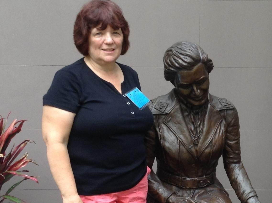 For more than three decades, Carol Richards has been involved in Girl Scouts, spending most of that time as a troop leader. Here, she's standing with a statue of Juliette Gordon Lowe in Savannah, Georgia, on a tour of the birthplace of Girl Scouts.   Photo courtesy of Carol Richards