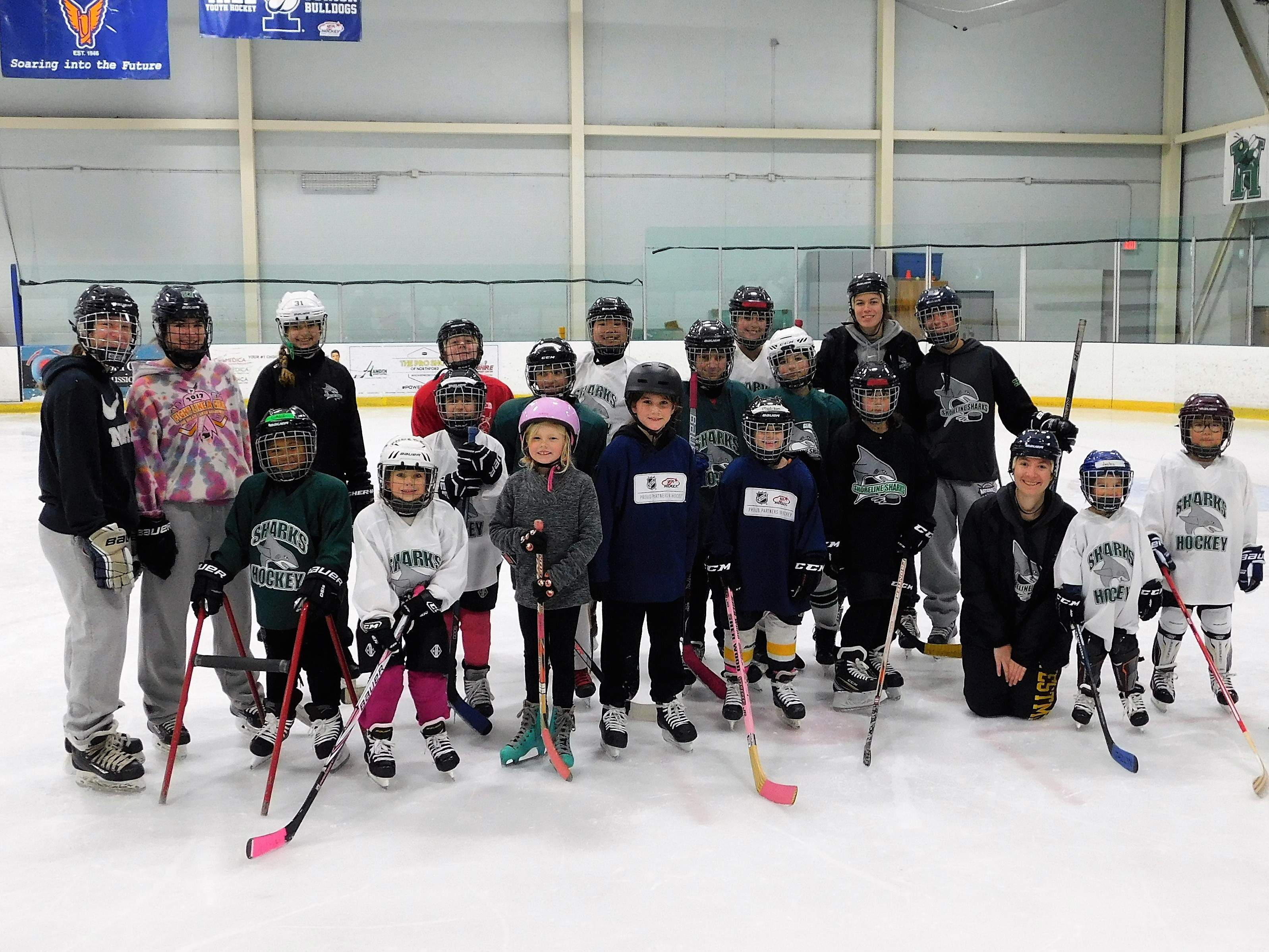 Girls learn the basics of hockey at a Shoreline Sharks Try Hockey for Free event.