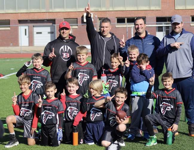The Branford Falcons won an overtime game against the Branford Lions to claim the Super Bowl title in the Ben Callahan Flag Football League. Pictured from the Falcons are (back) assistant coach Todd DeFelice, Head Coach Scott Penner, assistant coach John Knowlton, and assistant coach Paul Piscatello; (middle) Peyton Swanson, Gordie Noel, Kallen Moran, Cooper Knowlton, and Kellen Blanchette; (front) Tanner DeFelice, Ronan Halpin, Liam Mullen, Sam Penner, Bryce Levchuck, and PJ Piscatello. Photo courtesy of Liesl Knowlton