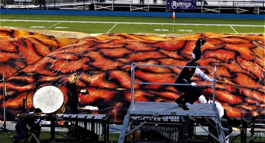 EHHS Co-op Marching Band Color Guard Instructor Catherine Velazquez fabricated and painted this gigantic flyover flag for the performance, shown here as it was pulled over the entire band by the Color Guard as part of the band's  field show 'In Ashes Ending'  at the 2019 USBands National Competition in Allentown, PA.  Photo Courtesy Matthew Laudano