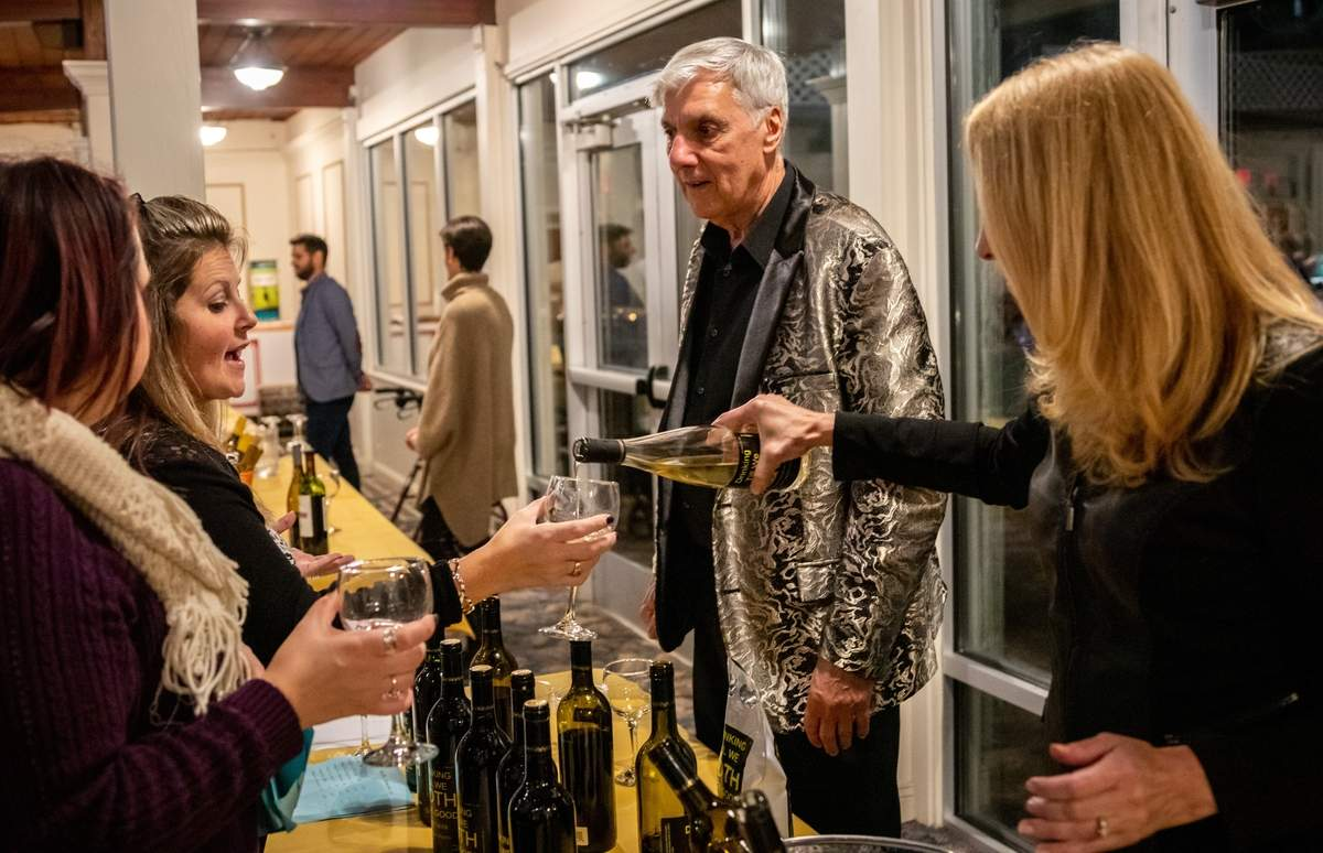 Westbrook Emblem Club 535 hosted its annual Wine, Beer, and Martini Tasting at the Westbrook Elks Lodge on Friday, November 8, 2019. There were also light refreshments and raffle prizes donated by local businesses. The Emblem Club gives back to the community by doing charitable work and are always looking for members. The event was sponsored by Westbrook Emblem Club 535 and Seaside Wines. Proceeds from the event benefit local charities and scholarship programs. Toni Zanks talks to Glenn Miele of GlennþÄôs Wine LLC. while being served some wine. Photo by Meglin Bodner/Harbor News