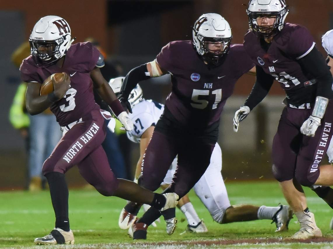 Corey Hooks (left) and the North Haven football team improved to 5-4 by notching a 42-14 win at Xavier on Nov. 15. Also pictured for the Indians are seniors Kyle Maruca (No. 51) and Josh Blumenthal (41). File photo by Kelley Fryer/The Courier