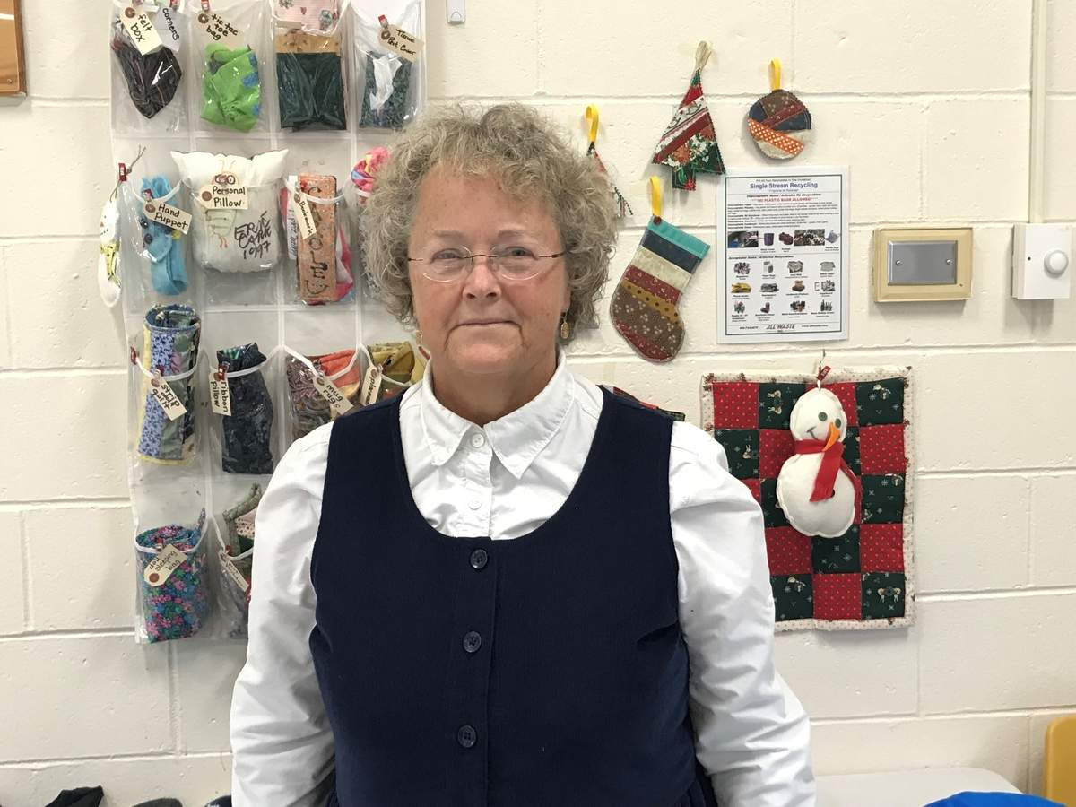 "For 30 years, with Suncatchers before and after school and summer programs for K-8 kids, founder Kathy Scott has been giving kids a safe, nurturing space to play and learn some ""lost art"" life skills with fun projects (some projects in progress can be spotted behind her). Kathy says the key is letting them choose to do what they'd like among many enriching activities offered. Photo by Pam Johnson/The Courier"