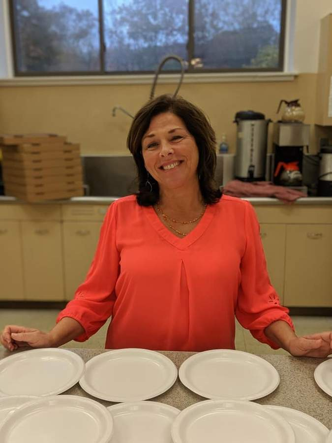 On Thanksgiving Day about 230 people in East Haven will receive a full-course turkey dinner. Rotarian Beth Capotorto is one of the volunteers helping ensure a holiday meal is available for all in need. Photo courtesy of Beth Capotorto
