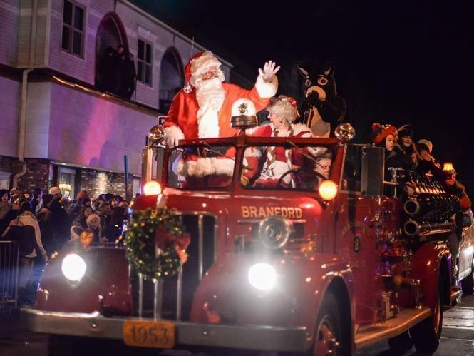 Special parade vehicles include Branford's circa 1930's red pumper fire truck carrying Santa and Mrs. Claus and Rudolph. File Photo by Kelley Fryer/The Sound