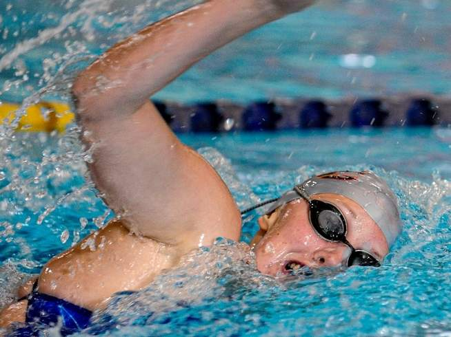 Sophomore Norah Rome earned top-10 finishes in the 200 freestyle and the 500 freestyle for the East Haven-Wilbur Cross girls' swim squad at the Class LL State Championship. Rome qualified to swim in both events at the State Open. File photo by Susan Lambert/The Courier