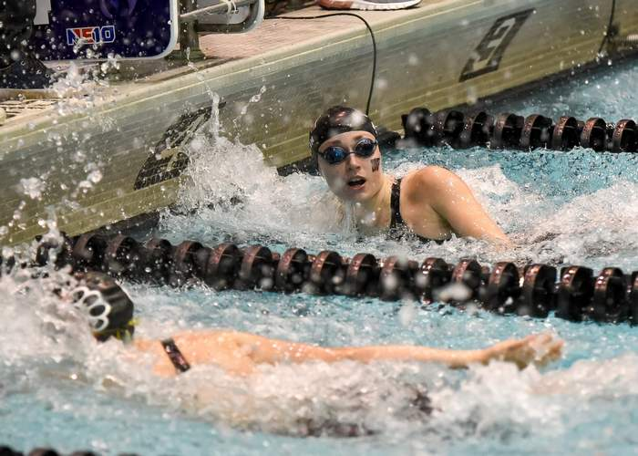 Junior Maddie Bergin touches the finish line to win the 50 freestyle for the second-straight campaign at the Class M State Championship. Bergin also won the 100 freestyle for the second year in a row at the meet. Photo by Kelley Fryer/The Courier