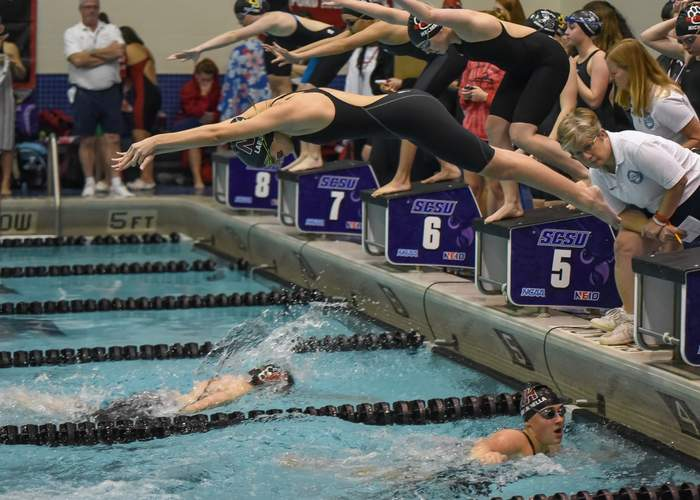 Sophomore Taya Laborde takes off in the 200 freestyle relay for North Haven at states. Laborde and her teammates Angela Gambardella (pictured on the right), Riley Jooss, and Maddie Bergin took first place and also set a new school-record time in the event. Photo by Kelley Fryer/The Courier