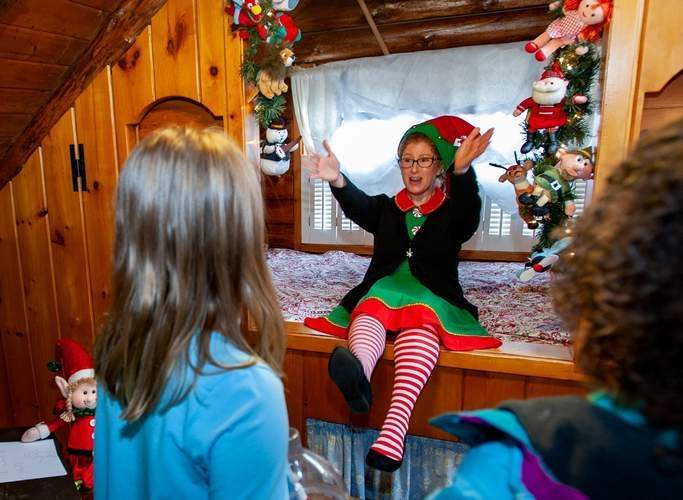 Cinnamon the Elf, a close personal friend of volunteer Michele Denye, greeted guests with jokes and one-liners at the Magical Elf House last year.   File Photo Susan Lambert/The Sound