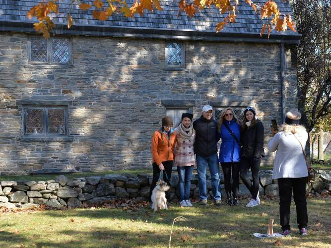 This family, visiting from Texas, lines up in front of the Henry Whitfield House during a past Harvesting History event.  Photo by Kelley Fryer/The Source