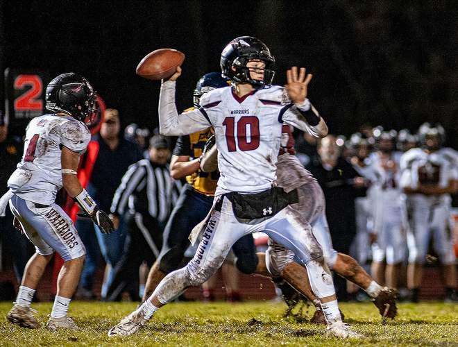 Junior quarterback Jack Cox (pictured) connected with DiAngelo Jean-Pierre for a 10-yard touchdown pass in the second quarter that helped the Warriors take a 13-2 lead against H-K when the two teams squared off on Nov. 26. Photo by Susan Lambert/The Courier