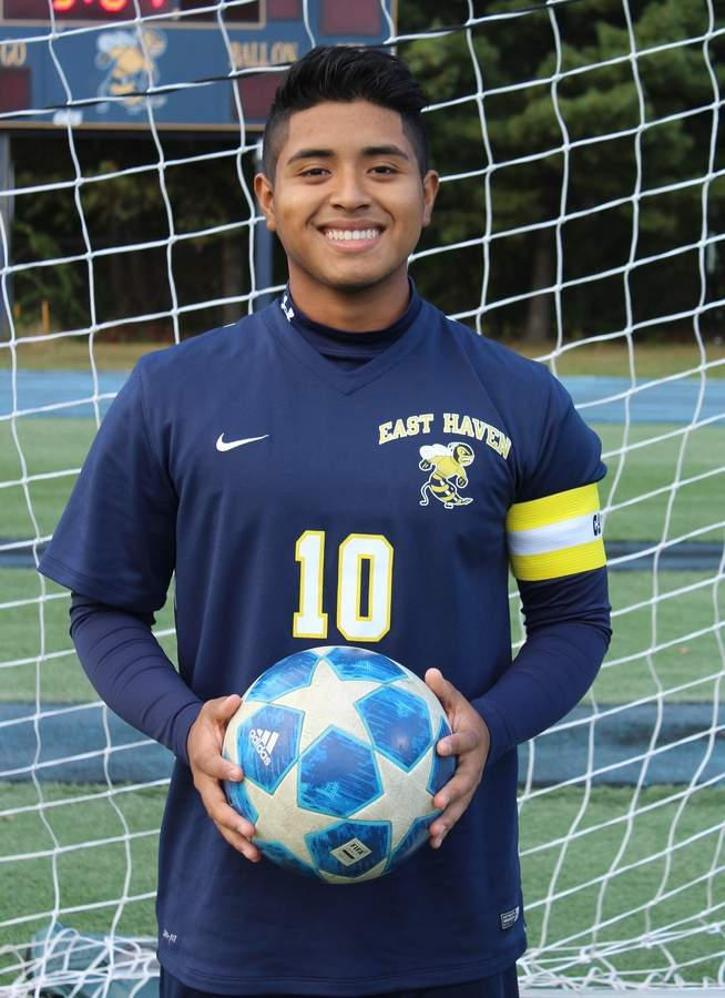 Diego Ortiz persevered through knee injuries during his career with the East Haven boys' soccer team. This year, Diego enjoyed a healthy senior season while leading the Yelllowjackets as a captain. Photo courtesy of Diego Ortiz