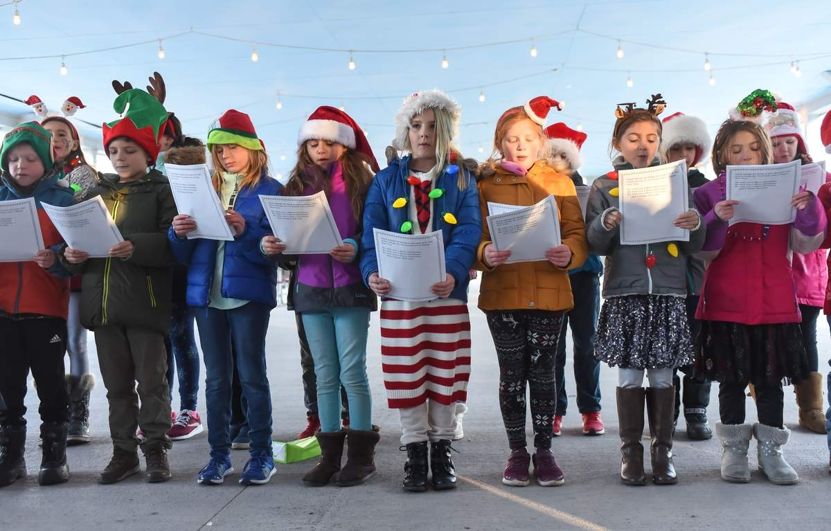 The holiday festivities at the Parmeelee Farm included caroling, hot chocolate and Santa, as well as a tree lighting. Mrs. Rubalsky directed the Killingworth Elementary School Select Choir. Photo by Kelley Fryer/The Source
