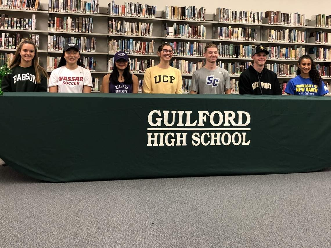 Seven Guilford athletes announced that they are going to play sports in college. Pictured are Madison Gambardella, Claire Mackenzie, Cat Larrow, Charlotte Wiley, Josh Wetteman, Aidan Henry, and Gabi Garcia-Perez. Photo courtesy of Lecia Scranton