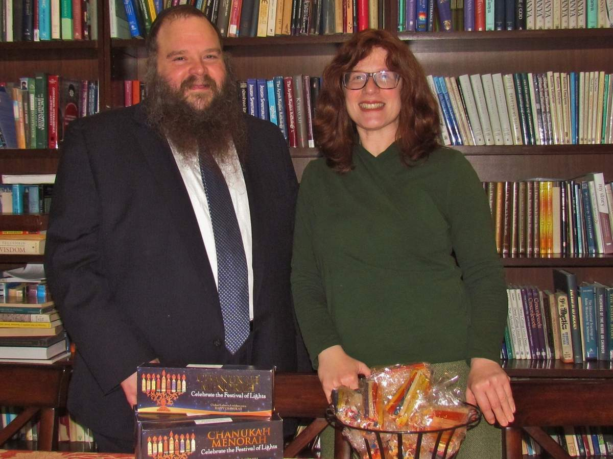 In addition to placing and tending public menorahs on town greens in Guilford, Branford, and East Haven, Rabbi Yossi Yaffe of Chabad of the Shoreline and his wife, Rochel Baila Yaffe, will host family-friendly Menorah Lighting celebrations in Branford on Sunday, Dec. 22 and Guilford on Sunday, Dec. 29 to help share the message of this Jewish holiday. Photo by Pam Johnson/The Courier