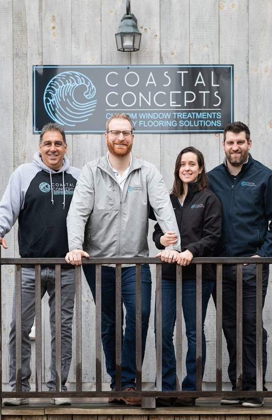 From left are Coastal Concepts' flooring installer Vincent Basilicato, owners Travis and Bryce Brestelli, and sales and installation manager Adam Brestelli.   Photo by Take AIM Photography