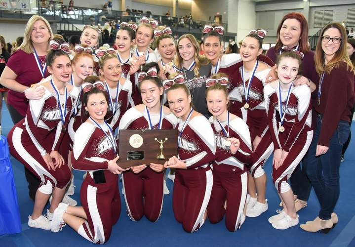 The North Haven cheerleading squad took home SCC and state championships this winter, followed by a second-place performance at the New England Championship. File photo by Kelley Fryer/The Courier