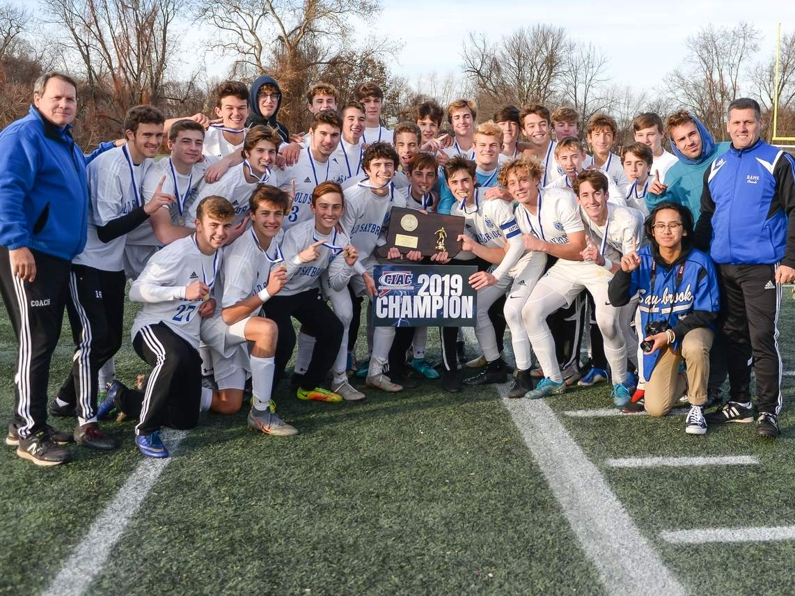 The Old Saybrook boys' soccer team sent out Head Coach Sam Barnes as a champion by earning a 3-1 double-overtime win against Holy Cross in the Class S State Tournament final. The victory gave the Rams their second-consecutive state crown.  File photo by Kelley Fryer/Harbor News