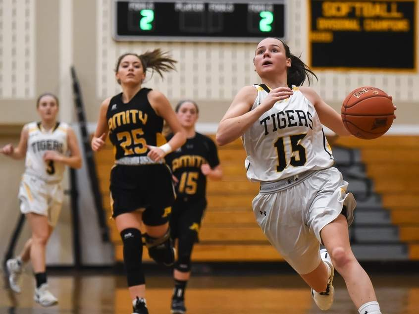 Senior captain Sara Wohlgemuth scored 22 points to lead the Hand girls' basketball team to a 60-35 victory against Amity on Jan. 10. Photo by Kelley Fryer/The Source