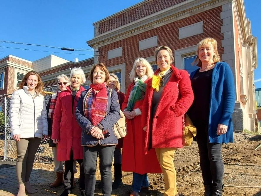 From left, Garden Club of Madison Nicole Wiles, Karin Peterson, Susan Rianhard, Sue Greaves, Pam Gallagher, Debbie Hernandez, Philippa Mannino, and Laura Downes gather to show support for the E.C. Scranton Memorial Library renovations.   Photo courtesy of the E.C. Scranton Memorial Library