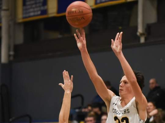 Giacomo Volpicelli is proving a sharpshooter from downtown for the Haddam-Killingworth boys' basketball squad. Volpicelli and the Cougars have been anything but shy about hoisting up 3-pointers this season. File photo by Kelley Fryer/The Source