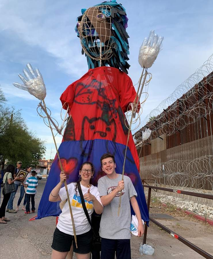 Art Beyond the Wall intern Tyler Eveland of Guilford (right) will puppeteer a 15-foot tall puppet like this one, which he helped to raise head and shoulders above the U.S.-Mexico border wall in May 2019, together with Art Beyond the Wall Executive Artistic Director and co-founder Jess Kaufman (left), at a free information sharing evening with Art Beyond the Wall at the Guilford Art Center on Friday, Feb. 7. Photo courtesy of Tyler Eveland