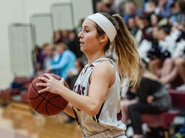 Senior Laura Petrafesa and the North Haven girls' basketball team improved to 11-5 on the campaign by earning wins in two of their three matchups last week. File photo by Susan Lambert/The Courier