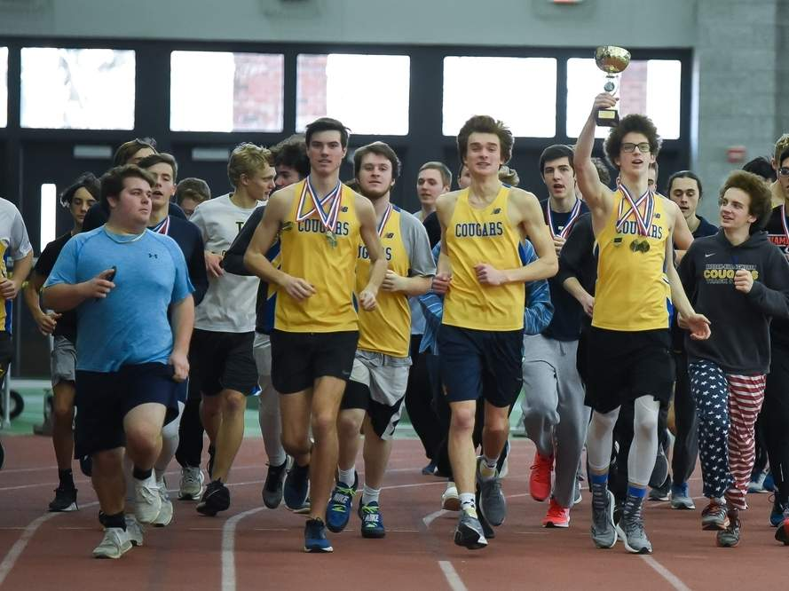 The Haddam-Killingworth boys' indoor track team takes a victory lap after winning the Shoreline Conference title for the second-straight season. The Cougars scored 170 points to place 62 points ahead of runner-up Old Saybrook at Floyd Little Athletic Center on Feb. 8. Photo by Kelley Fryer/The Source