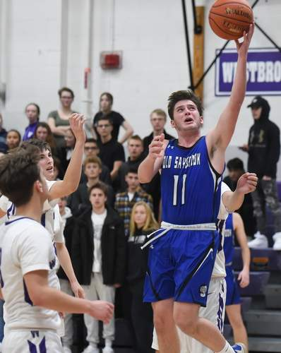 Davis Brown and the Old Saybrook boys' basketball squad picked up their first win of the season with a 72-71 overtime victory over Portland on Feb. 14.  File photo by Kelley Fryer/Harbor News