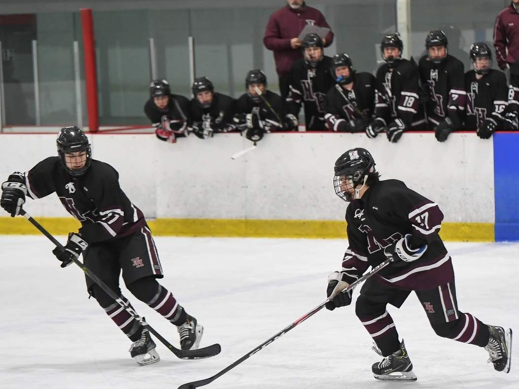Aaron Racino (right) assisted fellow junior Eli Brubacher for the game-winning goal in overtime when North Haven earned a 2-1 overtime victory versus Guilford last week. Pictured on the left is senior Jake Wentworth. File photo by Kelley Fryer/The Courier