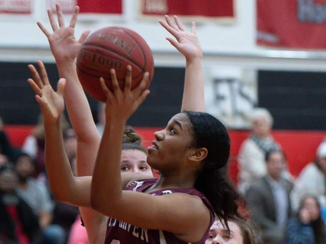 Sophomore Eveani Okwuosa and the North Haven girls' basketball team defeated Law in the first round of the SCC Tournament before losing to Hand in the quarterfinals last week. The Indians are competing in the Class L State Tournament beginning this week. Photo by Kelley Fryer/The Courier