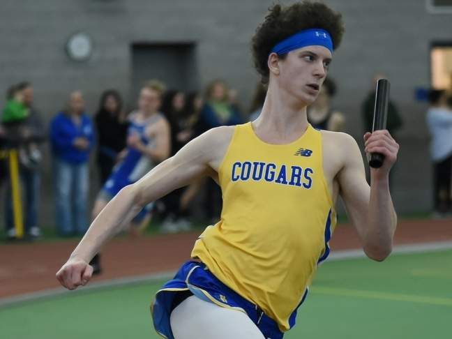 Senior Seth Regan and his cohorts claimed first place in the 1,600 sprint medley relay at the State Open Championship, helping the Haddam-Killingworth boys' indoor track squad finish in a tie for fourth place in the meet. File photo by Kelley Fryer/The Source